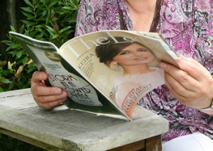 Image of lady looking through a magazine (Simon Emery @ SEA Photography)