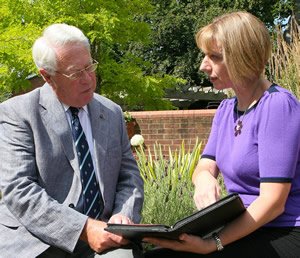 Image of Karen MacDonald interviewing a client (Simon Emery @ SEA Photography)